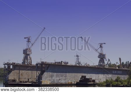 An Empty Floating Or Dry Dock In A Shipyard. Dock For Repair And Painting Of The Ship's Hull. Liftin