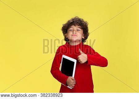 Thumb Up. Portrait Of Pretty Young Curly Boy In Red Wear On Yellow Studio Background. Childhood, Exp