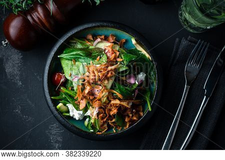 Gourmet Salad Served With Spinach, Lettuce On Black Background. Delicious Salad. Healthy Food. Diet