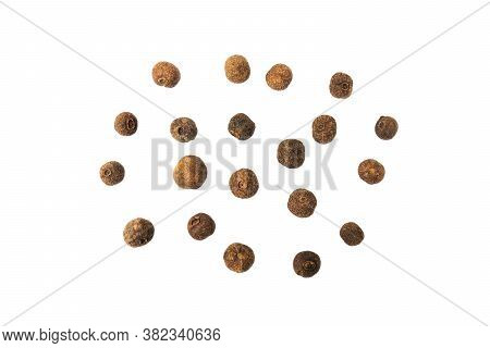 Dried Black Pepper Peas Isolated On A White Background With Clipping Path. Dried Black Pepper Seeds