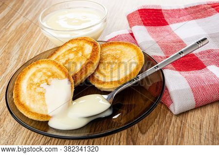 Bowl With Condensed Milk, Homemade Small Pancakes Poured Condensed Milk, Teaspoon In Brown Saucer, C