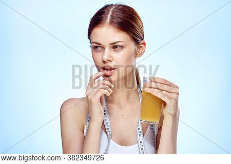 Woman With A Glass Of Drink Measuring Tape Slimming Slim Figure Health
