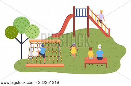 Children Spending Time At Playground. Kids Have Fun. Boy At Slide Stand At Stairs. Girl Wearing Dres