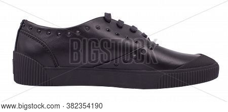 Side View Of Black Leather Sneaker, Isolated On White Background.