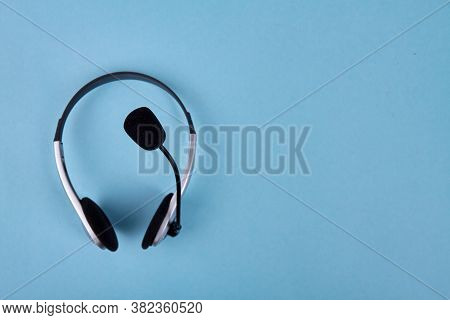 Helpdesk Headset And Copy Space. Isolated On Blue Background.