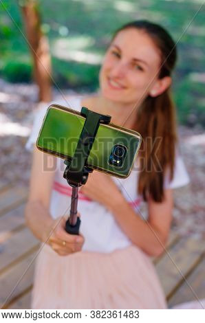 Closeup Of Smiling Young Woman Taking Selfie On Smart Phone Usin