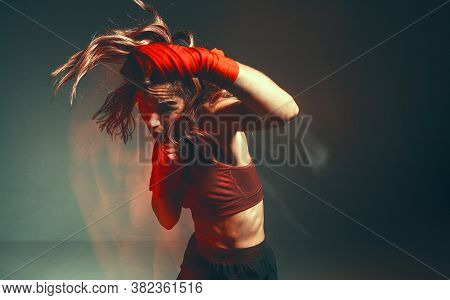 Cool Female Fighter In Boxing Bandages Trains In Studio In Red Neon Light. Mixed Martial Arts Poster