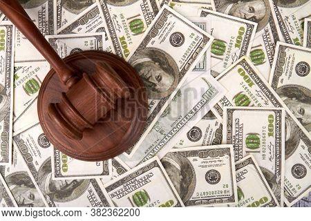Judge Hummer On Dollars Bacground. Judicial Corruption Concept. Wooden Hammer And Banknotes Backgrou