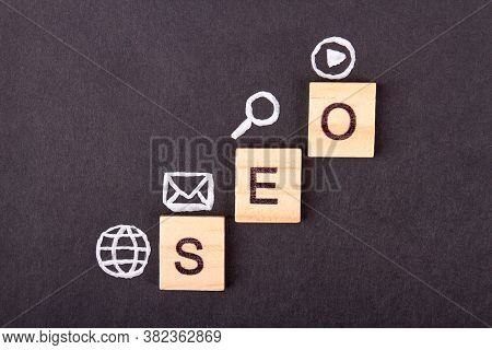 Search Engine Optimization For Business Results. Wooden Blocks With Abbreviation Seo And Icons On It