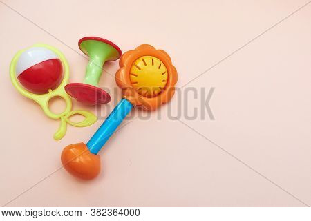 Plastic Retro Rattle. Baby Toys On Pink Background. Flat Lay. Copy Space.