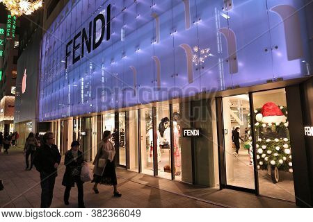 Tokyo, Japan - December 4, 2016: People Walk By Fendi High Fashion Store In Ginza District Of Tokyo,