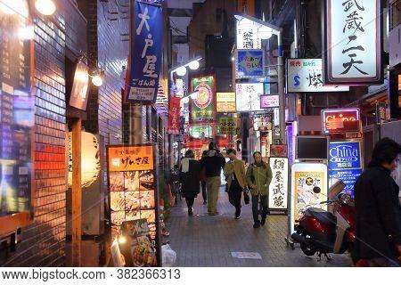 Tokyo, Japan - November 29, 2016: People Visit Narrow Streets Of Ikebukuro Restaurant Area In Tokyo,