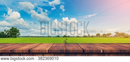 Rice Field Sunlight And Empty Wood Table For Product Display And Montage.