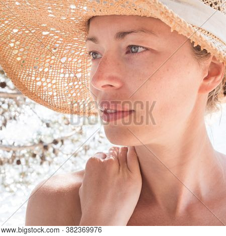 Close Up Portrait Of No Makeup Natural Beautiful Sensual Woman Wearing Straw Sun Hat On The Beach In