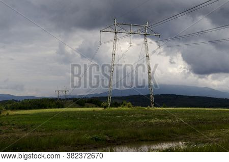 Springtime Forest With Glade And General Electric Power Transmission Line, Plana Mountain, Bulgaria