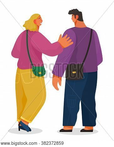 Man And Woman Talking To Each Other. Girl Glad To Meet A Friend Greets Him Friendly Pat On The Shoul