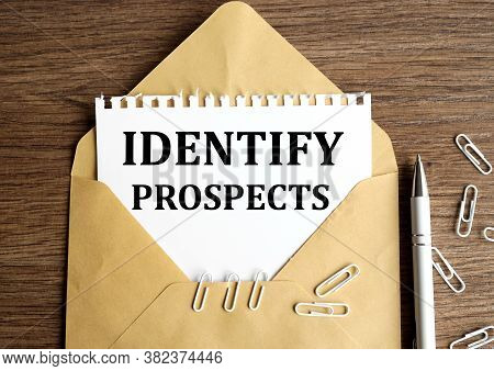 Identify Prospects. Text On White Paper In An Envelope On A Nineteen Table, Near White Paper Clips A