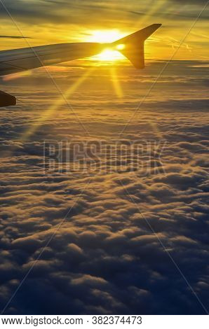 The Sun Rises On The Sky While Flying