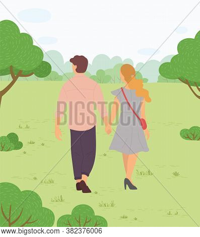 Man And Woman, Couple In Love Walking In Green Park And Looking Far Away At Forest On Horizon. Roman