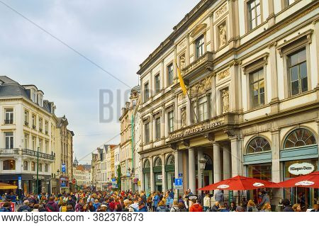 Brussels, Belgium - October 5, 2019: Crowd Of People On Old Town Street In Front Of The Saint-hubert