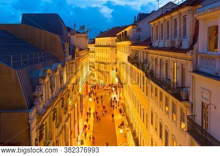 Lisbon, Portugal - January 28, 2020: Aerial View Of Old Town Shopping Street In Lisbon Crowded With