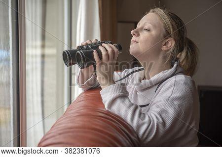Women In Late Twenties Spying With Binoculars Through S Window