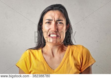 portrait of disgusted young woman