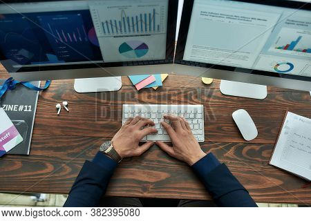 Top View Of A Businessman Or Financial Analyst Working On Computer, Analyzing Statistical Data, Grap