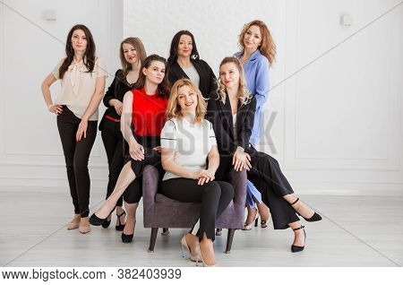 Happy Women Work Team Employees Group Looking At Camera Posing In Studio, Smiling Women Company Staf