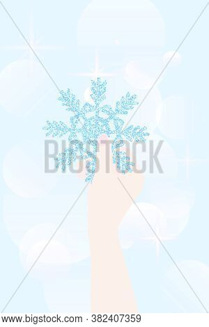 Snowflake In Hand. Shiny Blue Snowflake. Snowflake In Sparkles. Winter Illustration. Vector