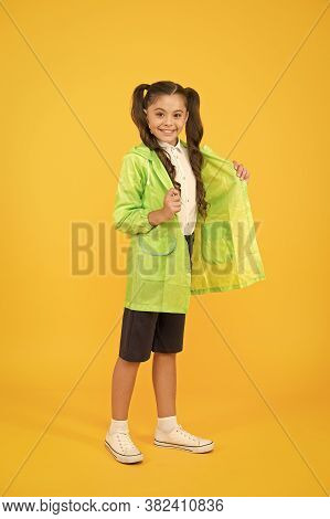 Season Is Changing. Small Girl Raincoat. Active Schoolgirl Waterproof Raincoat. Water Resistant Clot
