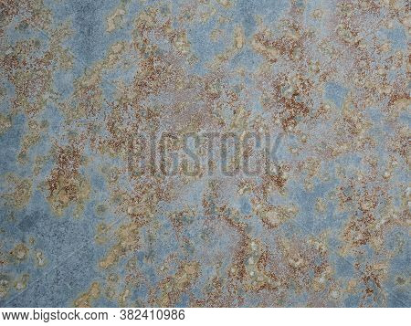 Texture Of Oxidized Metal With Brass And Aqua Patina. Rusty Metal Surface With Streaks Of Rust. Rust