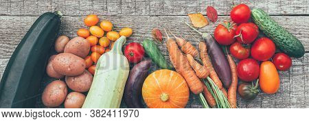 Assortment Different Fresh Organic Vegetables On Country Style Wooden Background. Healthy Food Vegan