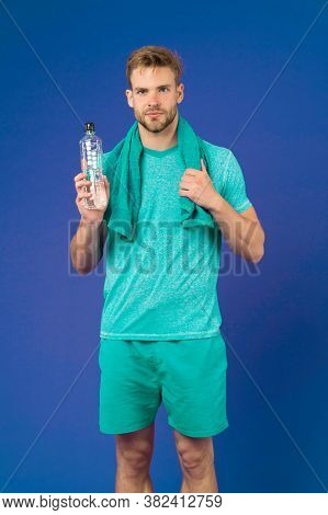 Stay Hydrated. Man With Towel On Shoulders Hold Bottle. Athlete Drink Hydration Mix With More Electr