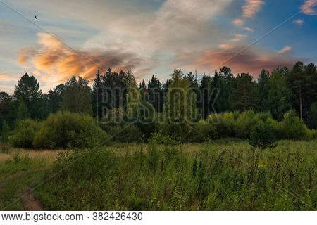 Evening Landscape Sunset In The Mountains In Early Autumn. Rural Landscape In The Evening At Sunset.