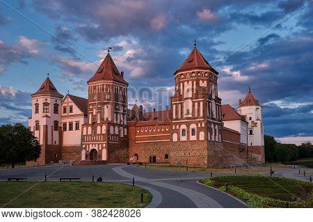 Belorussian Tourist Landmark Attraction Mir Castle At Sunset.