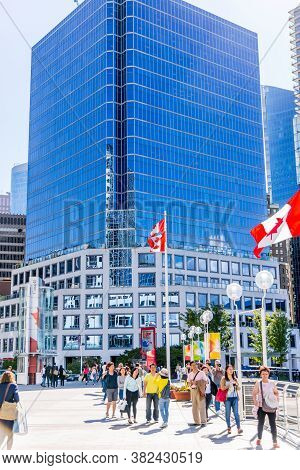 Vancouver, British Columbia / Canada - 07/01/2015. Canadian Flags Everywhere And People Enjoying The