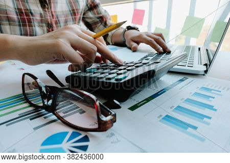 Woman Accountant Or Bookkeeper Use Calculator For Calculation Financial Report. Work For Safe At Hom