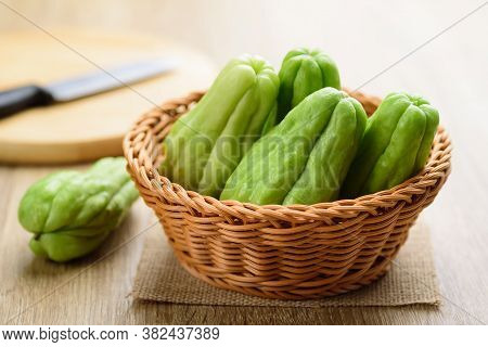 Chayote Squash Or Mirlition Squash In A Basket, Organic Vegetables