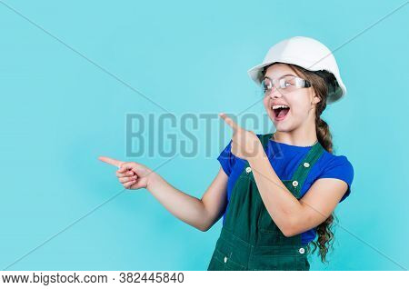 Look Here. Little Girl In Hard Hat Play In Workshop. Child Protection And Safety. Little Smiling Bui
