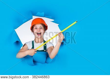 Little Girl Using A Measuring Tape. Construction Worker With Tape Measure. Cute Kid As A Constructio
