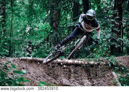 Russia, Moscow - August 26, 2020: Jump And Fly On A Mountain Bike. Cyclist In Action At Mountain Bik