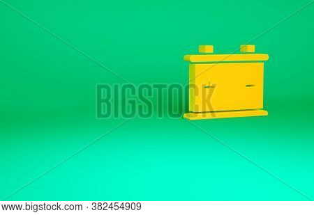 Orange Car Battery Icon Isolated On Green Background. Accumulator Battery Energy Power And Electrici