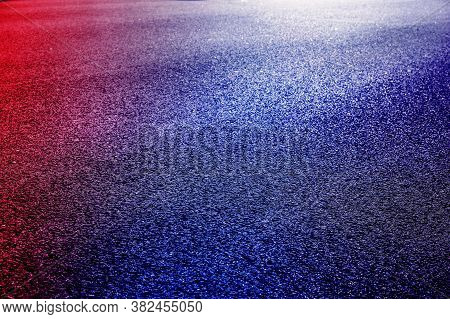 Abstract Image Of Empty Wet Asphalt Road With Neon Light Reflection Background.