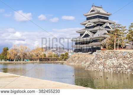 Matsumoto castle against blue sky in Matsumoto city in Nagano in Winter. Matsumoto Castle is an old historic castle in japan, its nickname is Crow Castle.