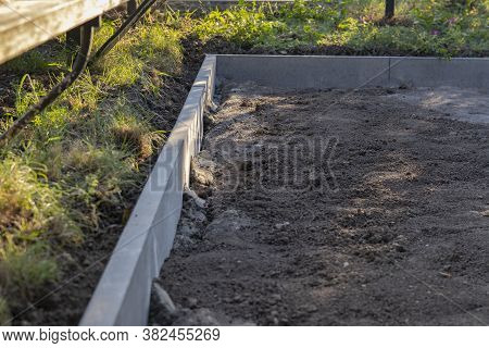Installation Of Curbs. Laying Curb Stones Using Concrete. Selective Focus.