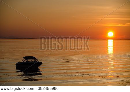 Motorboat Parked Near Fishing Pier In Blaine, Washington, During Summer  Gloaming Sunset