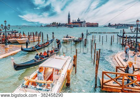 Venice, Italy - May 12, 2017 : Embankment Of The Grand Canal With Gondolas And Gondoliers. Italy.