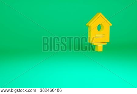 Orange Bird House Icon Isolated On Green Background. Nesting Box Birdhouse, Homemade Building For Bi