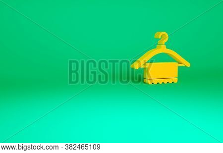 Orange Hanger Wardrobe Icon Isolated On Green Background. Clean Towel Sign. Cloakroom Icon. Clothes